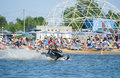 Man on snowmobile goes fast on the water in summer khabarovsk russia july Royalty Free Stock Image