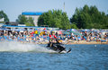 Man on snowmobile goes fast on the water in summer khabarovsk russia july Stock Photo