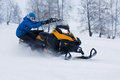 Man on snowmobile in winter mountain Royalty Free Stock Images