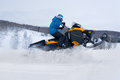 Man on snowmobile in winter mountain Stock Photo