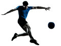 Man soccer football player flying kicking Royalty Free Stock Photos