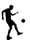 Man soccer player silhouette one in studio isolated on white background Stock Images