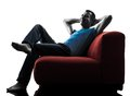 Man sofa coach relaxing one caucasian in silhouette isolated on white background Royalty Free Stock Photo