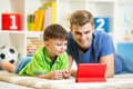 Man and son kid playing with tablet computer Royalty Free Stock Photo