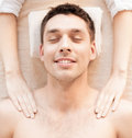 Man in spa close up of face salon getting massage Royalty Free Stock Image