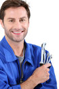 Man with spanners Royalty Free Stock Photo