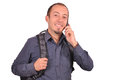 Man is speaking on mobile phone young attractive guy with backpack his cellphone white background Stock Photography