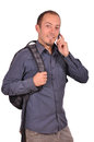 Man is speaking on mobile phone young attractive guy with backpack his cellphone white background Royalty Free Stock Photos