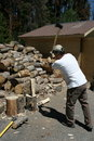 Man Splitting Firewood Royalty Free Stock Photos
