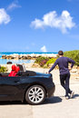 Man with sport car on the beach black watching Stock Images