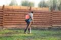 Man sprays grass with herbicide of a knapsack sprayer Royalty Free Stock Photo
