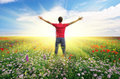 Man in spring meadow of flower. Royalty Free Stock Photo