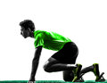 Man sprinter runner in starting blocks silhouette one caucasian young studio on white background Royalty Free Stock Image