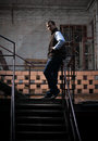 Man on stairs standing grungy Stock Image