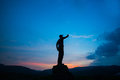 Man stand at sunset point finger to the moon Royalty Free Stock Photo