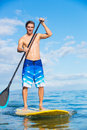 Man on stand up paddle board attractive sup tropical blue ocean hawaii Royalty Free Stock Image