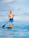 Man on stand up paddle board attractive sup tropical blue ocean hawaii Stock Photos
