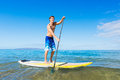 Man on stand up paddle board attractive sup tropical blue ocean hawaii Stock Photography