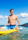 Man on stand up paddle board attractive sup tropical blue ocean hawaii Royalty Free Stock Photo