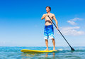 Man on stand up paddle board attractive sup tropical blue ocean hawaii Stock Image