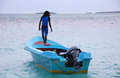 Man standing at blue motor boat Maldives Royalty Free Stock Photo