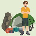 Man standing with camping equipment