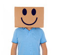 Man standing with a cardboard box on his head with smiley face Royalty Free Stock Photo