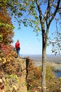 Man standing on a cliff above the mississippi river valley in fall Stock Image