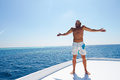 Man standing deck boat sun Royalty Free Stock Photos
