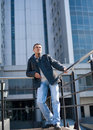 Man standing in front of a building Royalty Free Stock Images