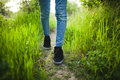 The man is standing in the grass. Vibrant background of lush blades of green grass Royalty Free Stock Photo