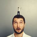 Man standing on the head and screaming small at megaphone Royalty Free Stock Images