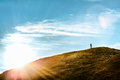 Man standing on a hill thinking in sunlight silhouette of Royalty Free Stock Photo
