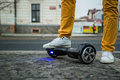Man standing with hoverboard on the street Royalty Free Stock Photo