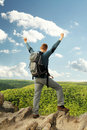 Man standing on mountain top happy Royalty Free Stock Photography