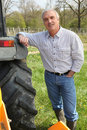 Man standing next to tractor Royalty Free Stock Photo