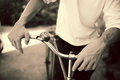 Man standing with retro bicycle close up photo tinted Stock Images