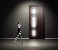 Man standing on stepladder and looking at the door serious Stock Photography