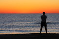 Man Standing Sunrise Sunset Beach Contemplation Royalty Free Stock Photo