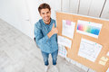 Man standing at task board and showing thumbs up gesture Royalty Free Stock Photo