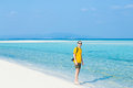 Man standing on tropical paradise beach okinawa japan with camera a deserted white sandy with clear water of a coral lagoon kondoi Royalty Free Stock Photography