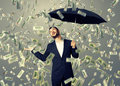 Man standing under money rain happy businessman with umbrella and looking up Royalty Free Stock Photography