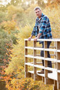 Man Standing On Wooden Balcony in Woodland Stock Photography