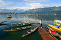 A man standing on the wooden bridge at pier in Srinagar, India Royalty Free Stock Photo