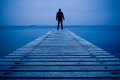 Man standing on a wooden pier Royalty Free Stock Photo