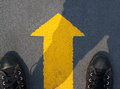Man standing with yellow arrow move forward to future Royalty Free Stock Photo