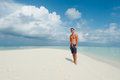Man stands on the beach with the blue sea and the beautiful sky white clouds Royalty Free Stock Images