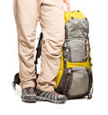 Man stands near packed backpack ready to go Royalty Free Stock Images