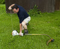 Man Starting A String Trimmer Royalty Free Stock Photo