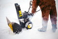 Man starts engine snow blower Royalty Free Stock Photo